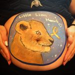 Baby bump painting lion cub