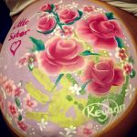 Hand painting baby bump art